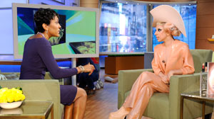"PHOTO Wearing a latex outfit, Lady Gaga talks about the charitable work she is doing along with MAC cosmetics to raise money for AIDS and to save lives worldwide, on ""Good Morning America"