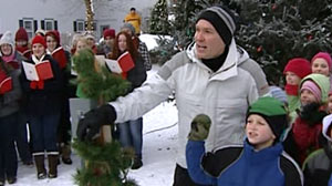PHOTO Sam Champion chats with kids in Essex, Vermont, Dec. 10, 2010.