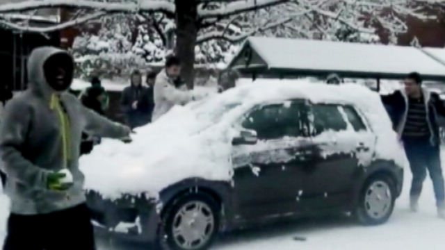 VIDEO: University of Oregon students were caught on tape hurling snowballs at moving vehicles.