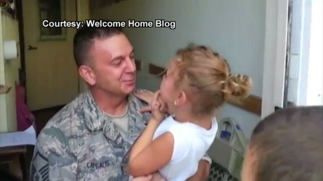 VIDEO: U.S. Airman Surprises Young Daughter at School, notices she lost a tooth.