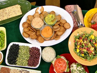 Diane Henderiks' creamy sundried tomato spread, roasted red pepper hummus, and mango guacamole are shown.