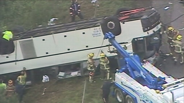 VIDEO: A commercial tour bus overturned near Kings Dominion theme park.