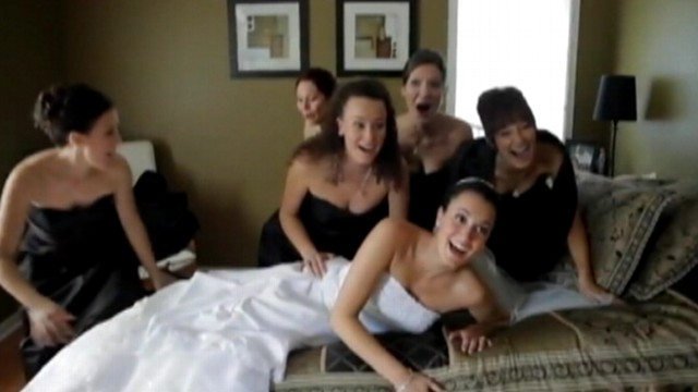 VIDEO: The weight of six women take down a mattress during photo shoot.