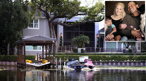 PHOTO The back of Tiger Woods home is seen on December 3, 2009 in Windermere, Florida./ Inset: In this photo provided by the Tiger Woods family, from left: Sam, Elin, Tiger, and Charlie Woods, are shown in this file photo.
