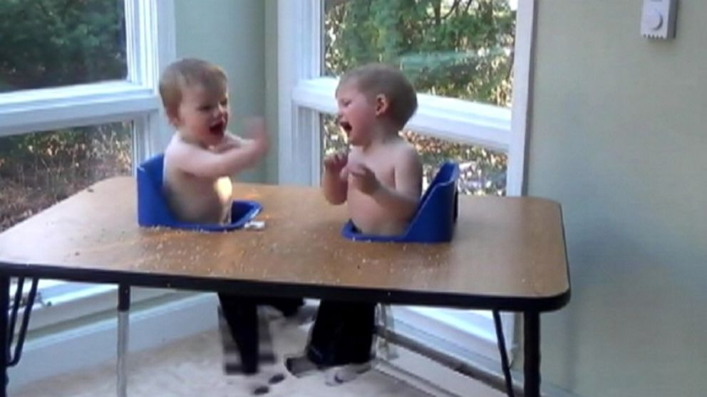 Twin brothers, Henry and Graham, have far too much fun at dinner time.