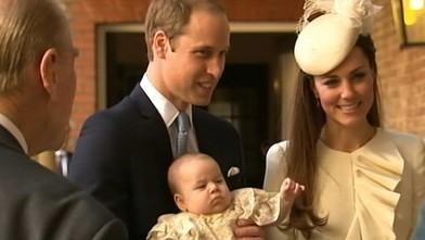 VIDEO: Prince George rests in his fathers arms before being taken into the Chapel Royal.