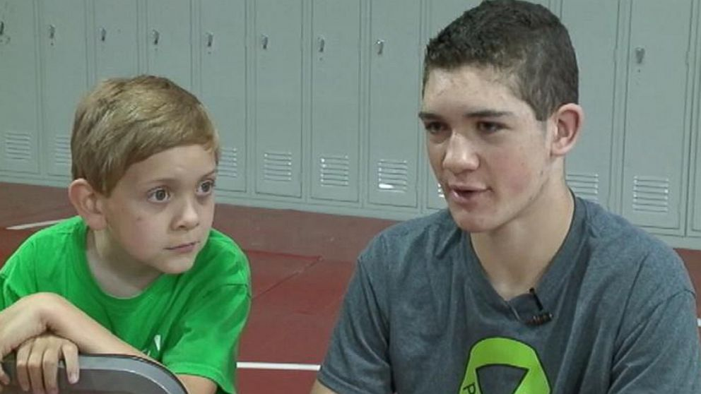 Hunter Gandee will walk from his high school to the University of Michigan with his brother, 7, on his back.