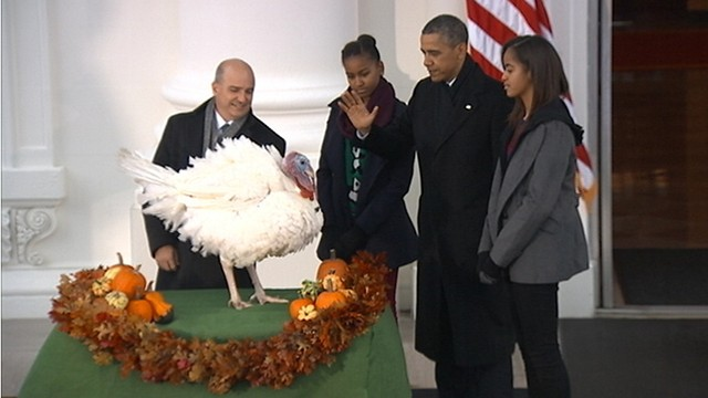 VIDEO: The president makes good on a White House tradition for two lucky turkeys.