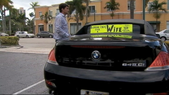 VIDEO: A Florida man posts a sign in his car looking for a wife.