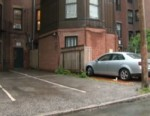 VIDEO: A woman spends over half a million dollars for two off-street spaces in the city.