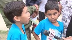 VIDEO: The boys, 8, are back with their family after fighting the suspect in San Antonio.