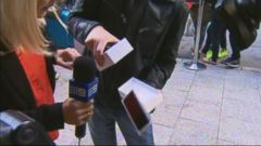 VIDEO: The Apple customer was the first person to buy the new iPhone in Perth, Australia.