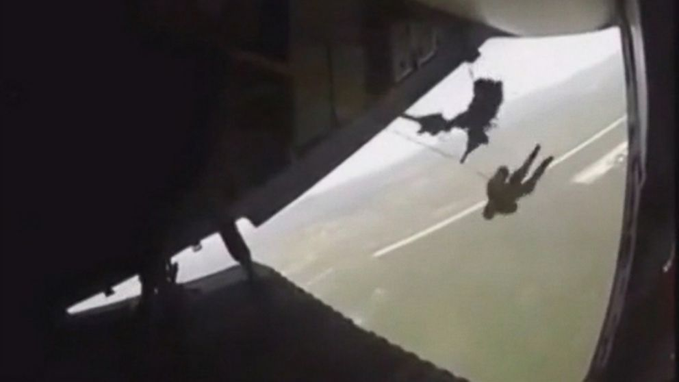 VIDEO: The soldier was left dangling from a plane after his parachute got caught during a military exercise in Mexico.