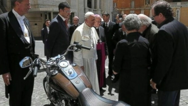 VIDEO: The 77-year-old pontiffs motorcycle will be auctioned off next month for charity.