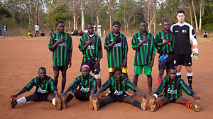 PHOTO Josh Nesbit playing soccer with a sports team in Malawi.