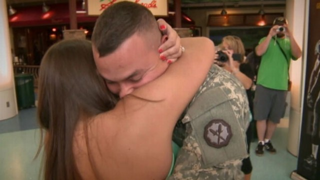 VIDEO: Sgt. Eric Parker gets down on one knee at Florida airport after 11-month deployment in Cuba.