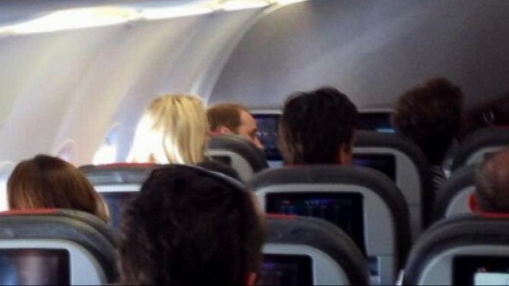 VIDEO: Prince William flew in economy class aboard an American Airlines plane.