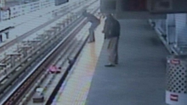 VIDEO: The toddlers mother jumped onto the tracks to save her child.