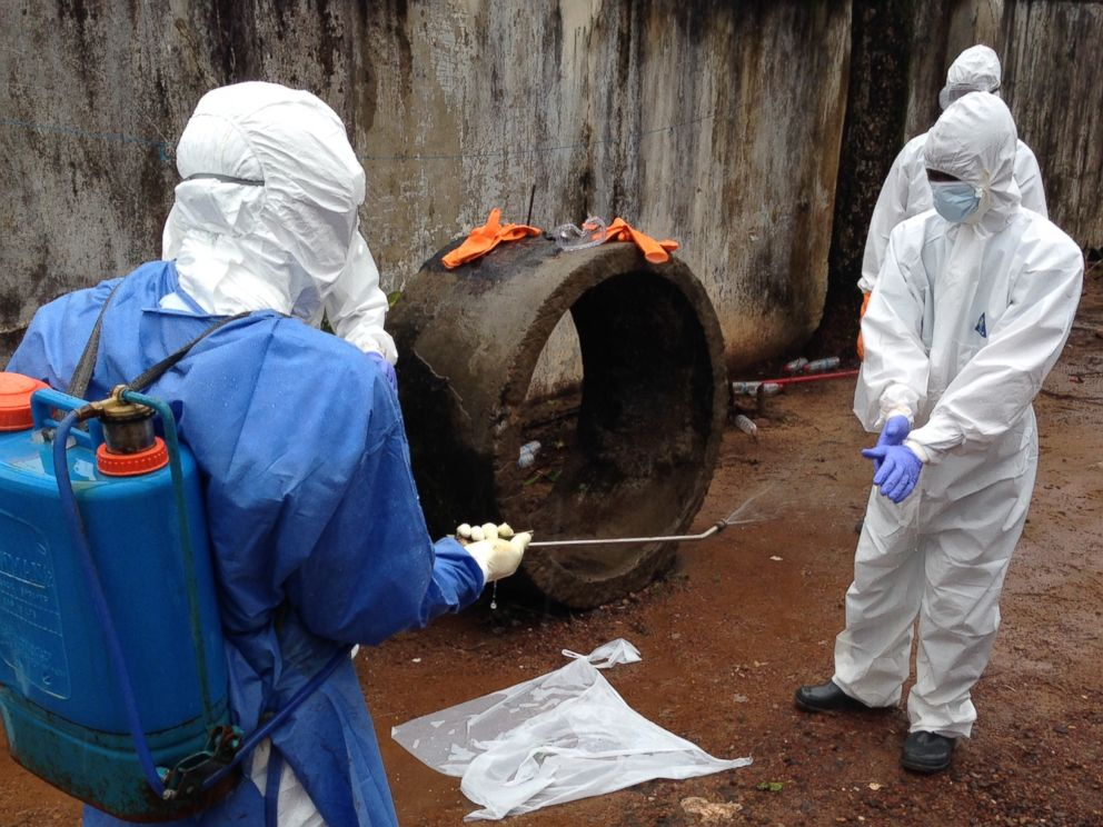 PHOTO: Ebola workers are pictured disinfecting in Liberia.
