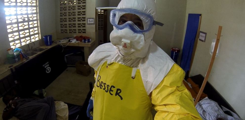 PHOTO: Dr. Richard Besser looks out from behind the many layers of protective gear needed to enter the Ebola ward.