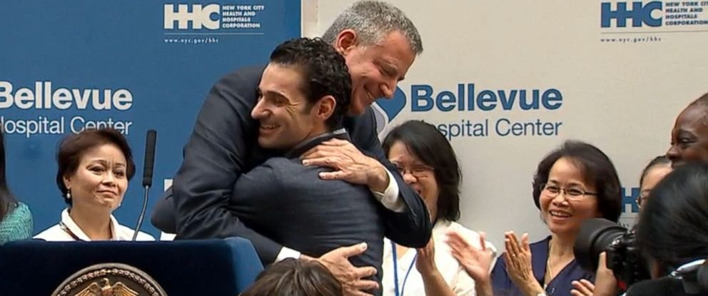 PHOTO: Dr. Craig Spencer and NYC Mayor Bill de Blasio are pictured embracing at a press conference after Spencer was declared free of Ebola and discharged from Bellevue Hospital.
