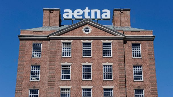 PHOTO: A sign for Aetna Inc., sits atop a building at the company headquarters, on Aug. 19, 2014, in Hartford, Conn.