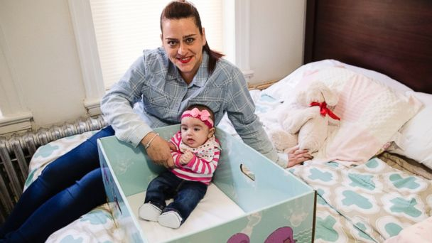 PHOTO: Dolores Peterson and her three-month-old daughter Ariabella pose for a photograph at their home in Camden, N.J., March 6, 2017.