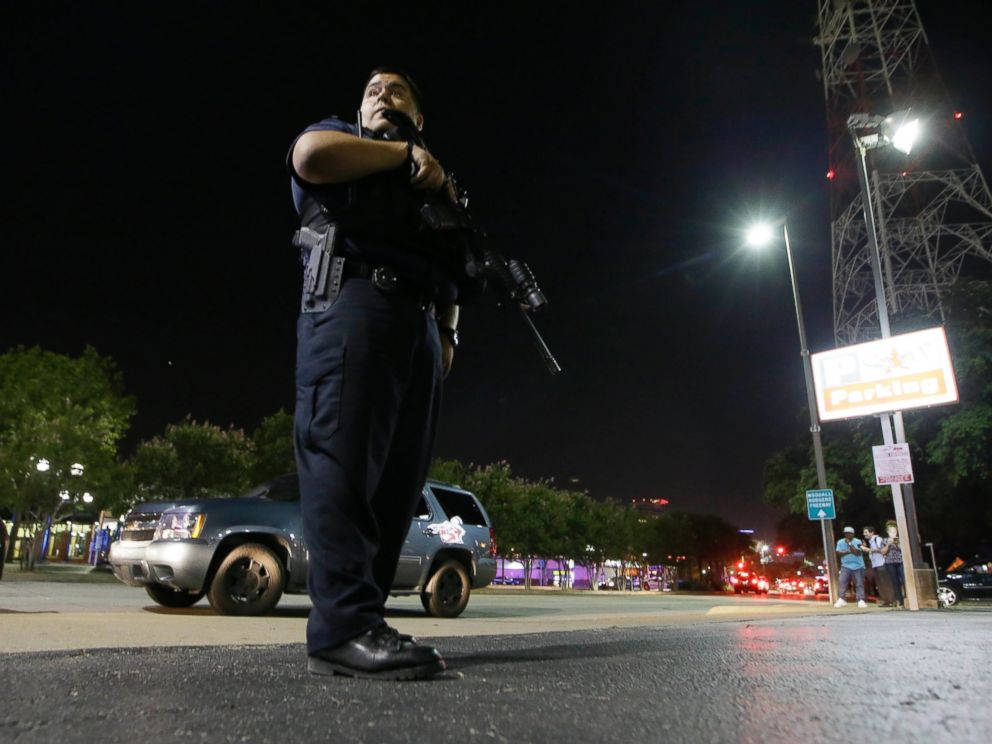 PHOTO: Dallas police stand watch after police officers were shot in downtown Dallas, July 7, 2016.