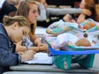 PHOTO: Students work in class with two infant simulators, in Henderson, Ky., Oct. 6, 2011.