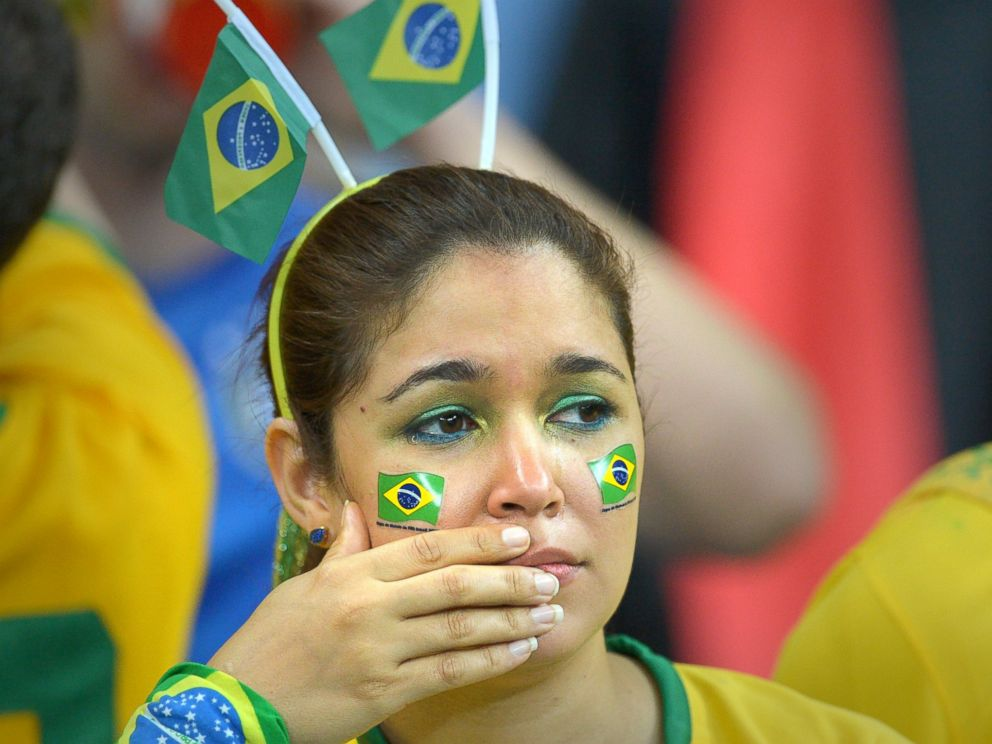 PHOTO: A supporter of Brazil in tears is pictured during the FIFA World Cup 2014 semi-final soccer match between Brazil and Germany at Estadio Mineirao in Belo Horizonte, Brazil on July 8, 2014.