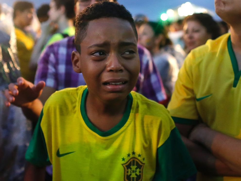 PHOTO: Brazil soccer fans cry as they watch their team get beat during a live telecast of the semi-finals World Cup soccer match between Brazil and Germany, inside the FIFA Fan Fest area on Copacabana beach in Rio de Janeiro, Brazil on July 8, 2014.