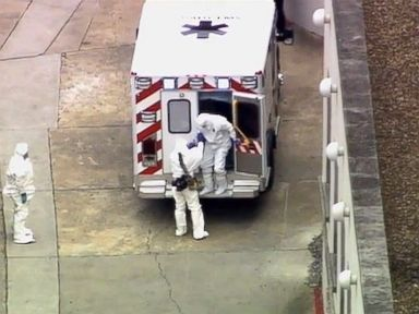 PHOTO: An ambulance arrives with Ebola victim Dr. Kent Brantly, right, to Emory University Hospital, Saturday, Aug. 2, 2014, in Atlanta.