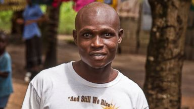 PHOTO: Sulaiman Kemokai, an Ebola virus survivor, is pictured near his house in Sierra Leone on Aug. 11, 2014.