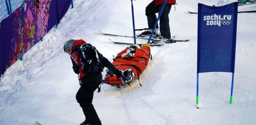 PHOTO: United States Heidi Kloser is stretchered off the course after crashing in a warm up run in the womens moguls at the Rosa Kutor Exreme Park during the 2014 Sochi Winter Olympics, Feb. 6, 2014, in Krasnaya Polyana, Russia.