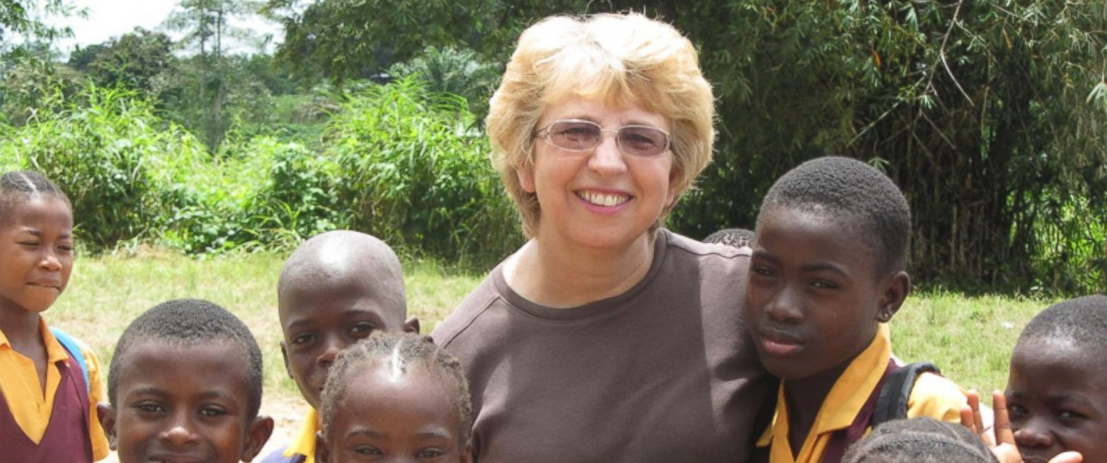 PHOTO: This Oct. 7, 2013 photo provided by Jeremy Writebol shows his mother, Nancy Writebol, with children in Liberia.