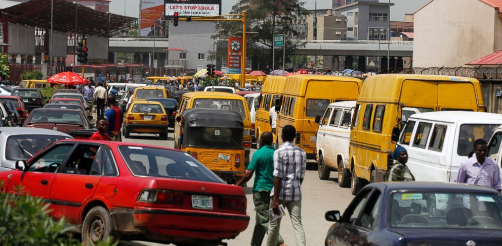 PHOTO: Cars drive past a giant electric board warning people of the Ebola virus near a hospital were Liberian-American Patrick Sawyer died in Lagos, Nigeria, Oct. 20, 2014.