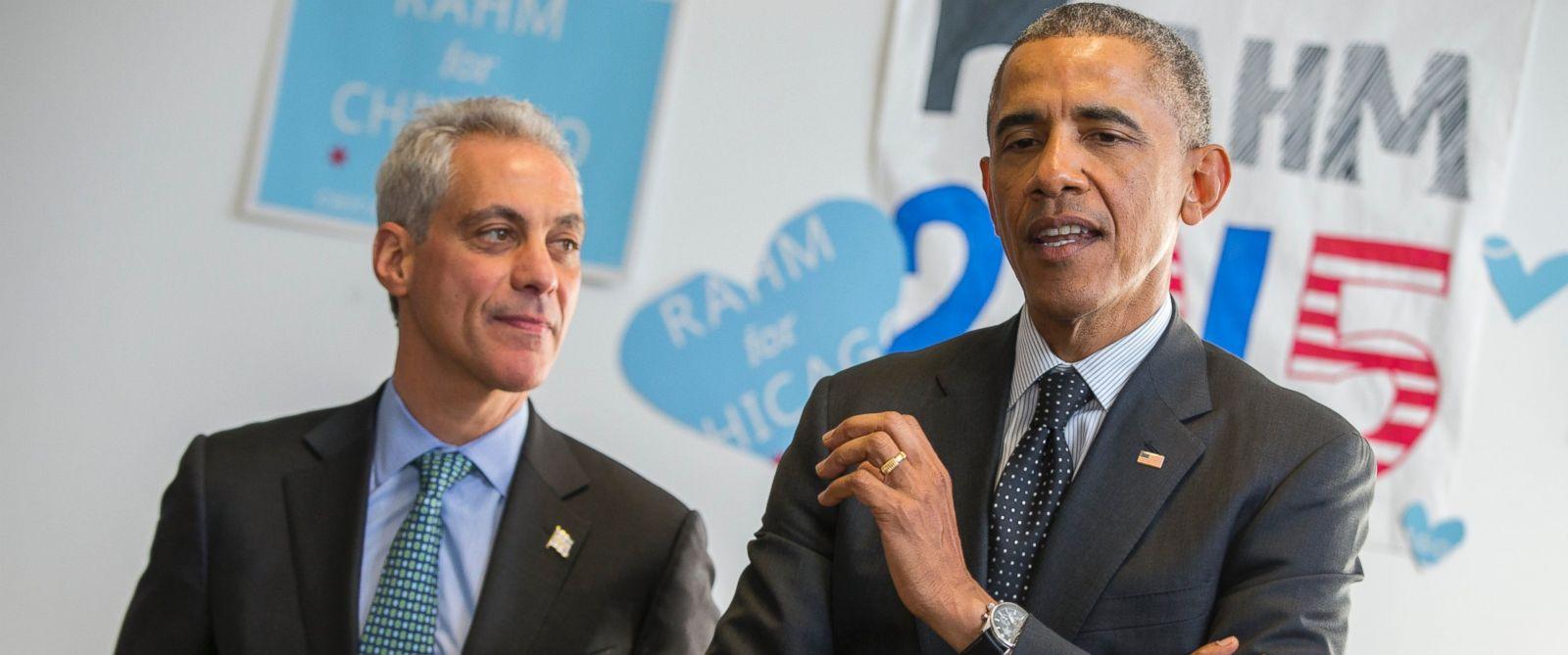 PHOTO: Chicago Mayor Rahm Emanuel listens as President Barack Obama speaks on behalf of Emanuel during a campaign stop in Chicago, Feb. 19, 2015.