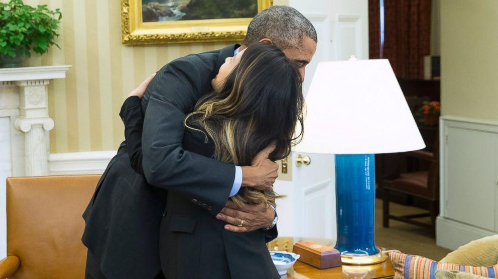 PHOTO: President Barack Obama hugs Ebola survivor Nina Pham in the Oval Offic