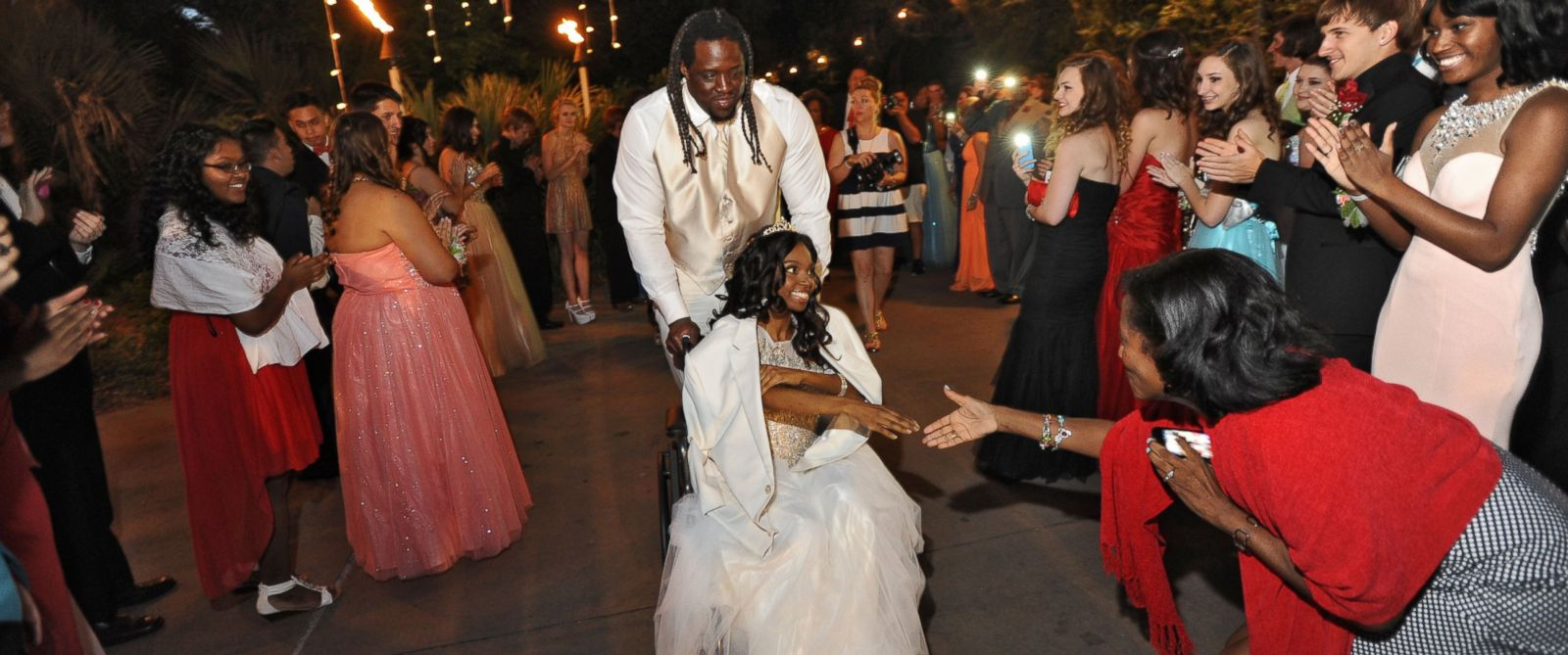 PHOTO: SenDerrick Marks escorts 18-year-old cancer patient Khameyea Jennings to her senior prom