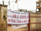PHOTO: A sign reading Kill Ebola Before Ebola Kill You, is seen on a gate forming part of the countrys Ebola awareness campaign in the city of Freetown, Sierra Leone, Sept. 14, 2014.