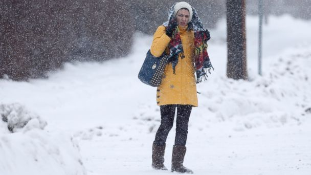PHOTO: A pedestrian waits to cross a street in the Beverwyck neighborhood in Albany, Feb. 13, 2014.