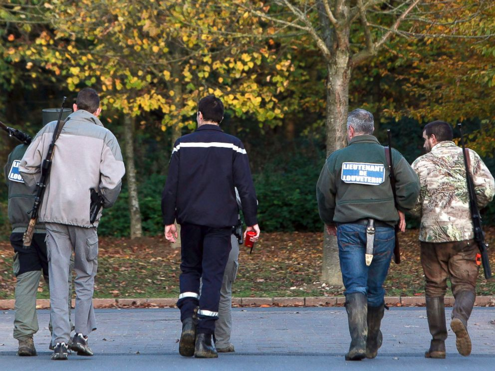 PHOTO: Members of the police animal brigade walk through the streets of Montevrain, east of Paris, Nov. 13, 2014.