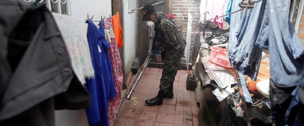 PHOTO: A soldier fumigates a house as part of the citys effort to prevent the spread of Zika virus vector, the Aedes aegypti mosquito, in Tegucigalpa, Honduras, July 20, 2016.
