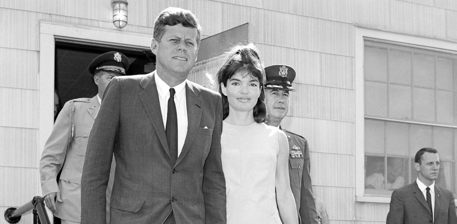 PHOTO: John F. Kennedy with his wife Jackie as they leave the Otis Air Force Base hospital