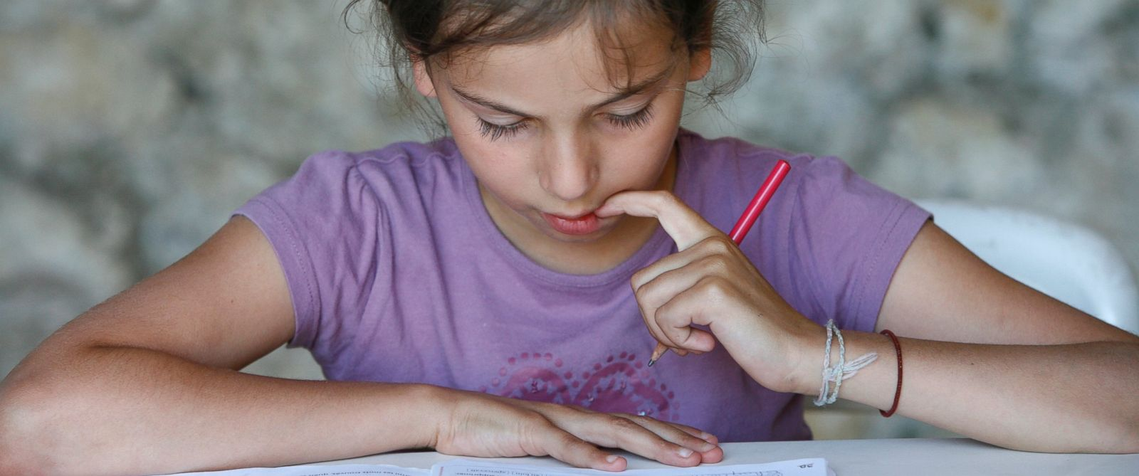 PHOTO: A girl doing her homework in this undated photo.