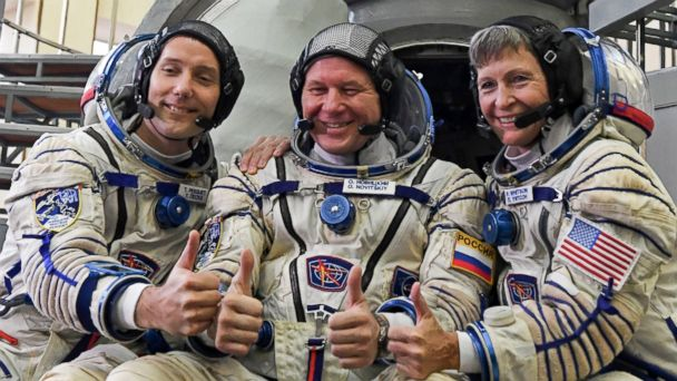 PHOTO: From left, France's astronaut Thomas Pesquet, Russia's cosmonaut Oleg Novitsky and US astronaut Peggy Whitson posing for pictures in front of a Soyuz space vehicle simulator outside Moscow.