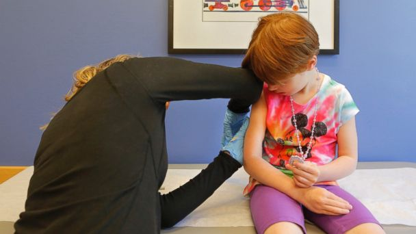 PHOTO: Kiara Boisvert, 5, gets a varicella booster vaccination from Amy Moran, a clinical assistant at Intermed in South Portland, June 4, 2015.