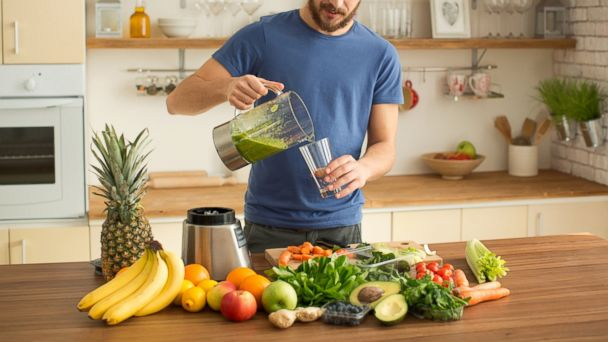 PHOTO: A man prepares a fruit and vegetable juice in this undated stock photo.