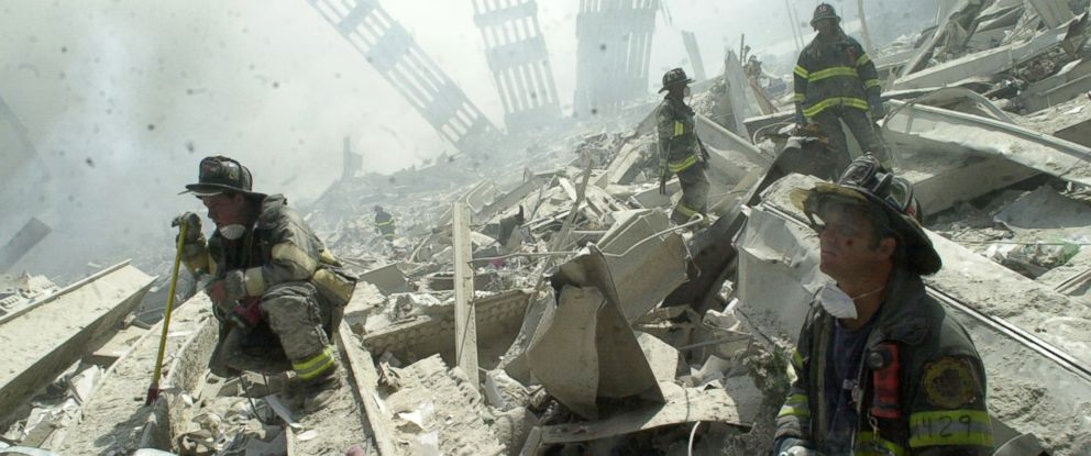 PHOTO: Firefighters search through the rubble of the World Trade Center after it was struck by a commercial airliner in a terrorist attack.