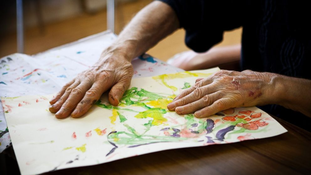 PHOTO: A patient participates in an art therapy class in a retirement home in Rueil Malmaison, France. This retirement home houses people suffering from Alzheimers disease and related dementia.